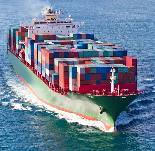 Cargo ship with ocean shipping containers for transport