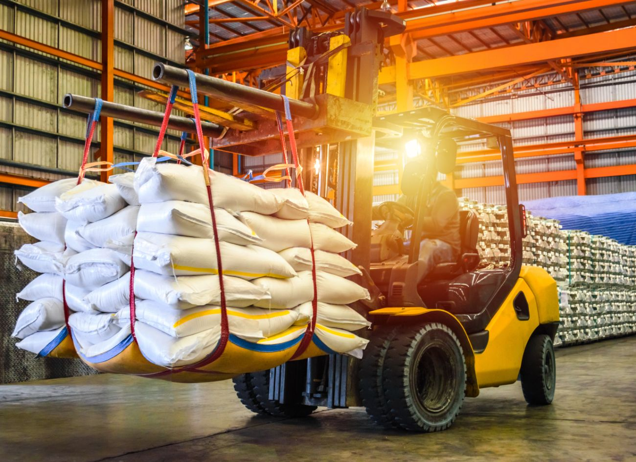 Forklift driver material handling at food warehouse for raw goods
