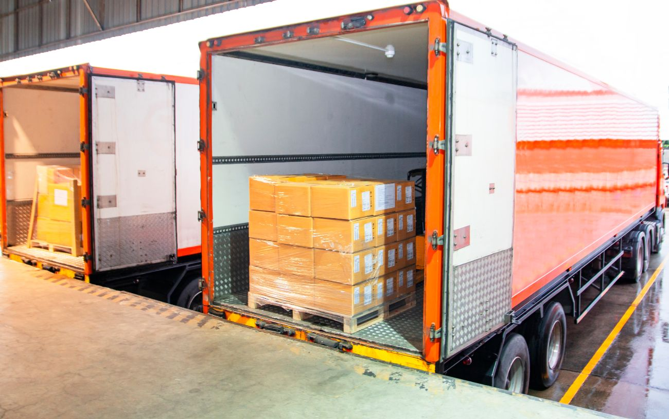 Food products loaded onto food distribution truck for delivery