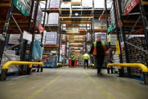 Blurred workers moving in a stocked warehouse